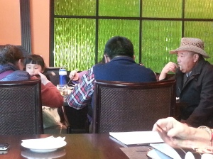 You have to love a Chinese man wearing a cowboy hat at a five-star Thai restaurant at the Wyndam Hotel in Kunming
