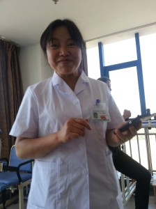 """Shenjie ... This picture was very hard to take because she always refused to take a picture. Most of the women in the hospital do not like to have their picture taken because they always tell me they did not have their makeup on, their hair was not pretty that day or had a bad """"looking day."""" Women! :-)"""
